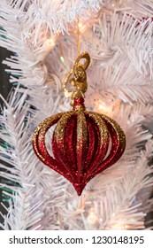 Red and  Gold Christmas Holiday Tree Decorative Ornaments on a White Tree.