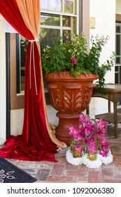 Red and gold curtain and flowers