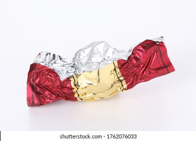 red and gold empty candy wrapper isolated on white background with copy space for your text