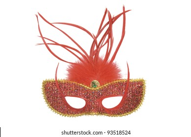 Red and gold feathered masquerade mask on white background