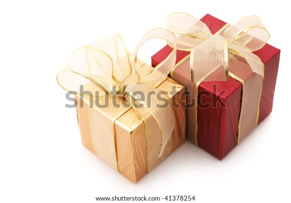 Red and gold foil gifts with gold translucent bows isolated on white background.