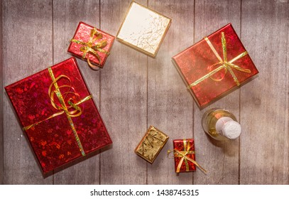 Red and gold gift boxes on  wooden background