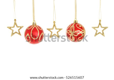 ef1e34928000 Red and gold glitter Christmas baubles and stars hanging in a line isolated  against white