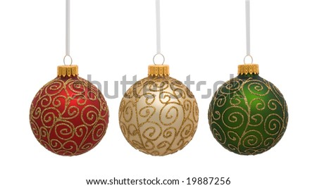 red gold and green christmas ornaments on white