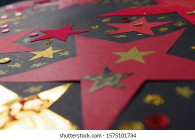 Red And Gold Stars Mixed Media Against A Black Background