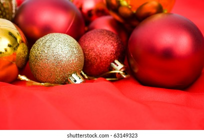 red and golden christmas balls on red background.