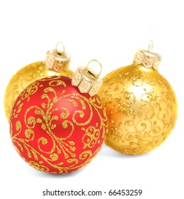 Red and golden christmas balls over white background, shallow depth of field