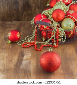 Red and Golden Christmas Balls in Wooden Box. Square Background.