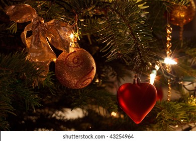 Red and golden christmas decorations in real tree