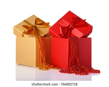 Red and golden classic gift boxes with satin bows and beaded garlands isolated on white background
