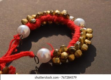 red and golden ghungru (gudagru)
