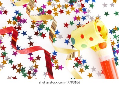 red and golden spirals, small confetti stars and yellow dotted blower on white background, party time