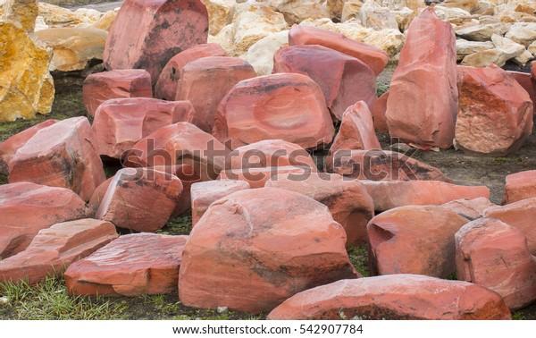 red granite, cobblestone wall, close up texture