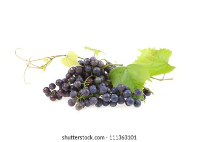Red grape with leaves isolated on white background