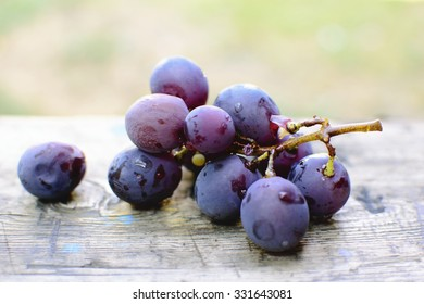 Red grape on wooden table, closeup