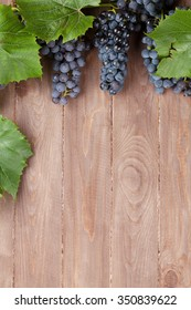 Red grape on wooden table. Top view with copy space