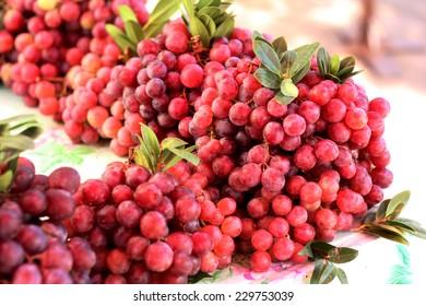 Red grape sale in local market.
