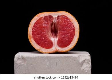 Red grapefruit looking like female vagina, vulva symbol