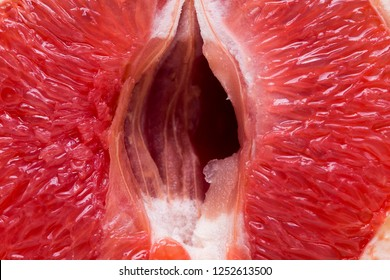 Red grapefruit looking like female vagina, vulva symbol