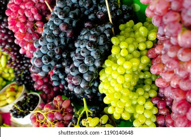 Red grapes background, dark grapes, blue grapes, red grape in local market. Healthy fruits/food concept.