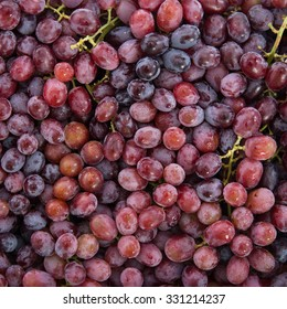 red grapes background with water drops