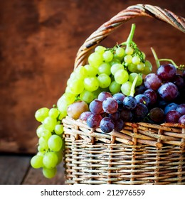 Red Grapes in Basket, wooden background, country style