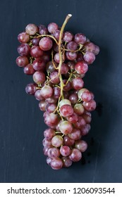 Red grapes on a black background