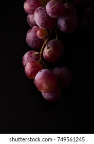 Red Grapes on black background