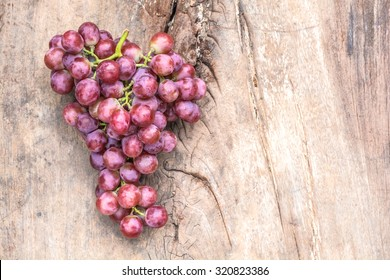 red grapes on old wooden table