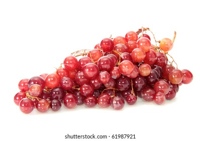 Red grapes on a white background are isolated.