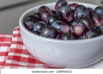 Red grapes over a checkered napkin