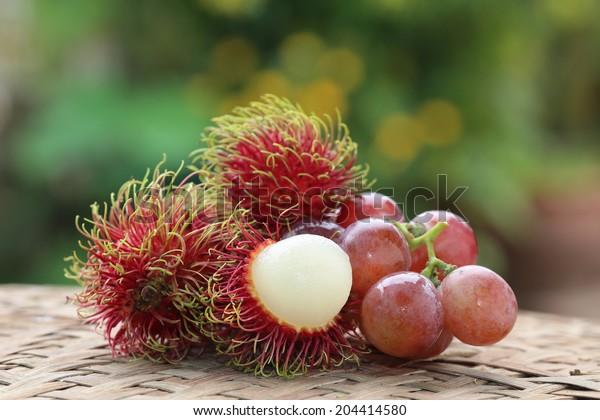 Red grapes and rambutan