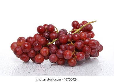 red grapes wet on white background