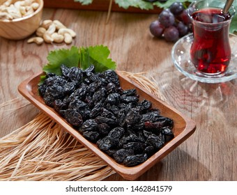 Red grapes in a wooden plate and top angle