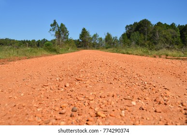 A red gravel road with no people in Alabama, USA