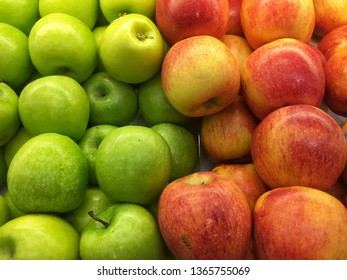 Red and green apples background. contrast concept