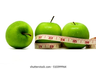 Red and green apples with measuring tape isolated on white background