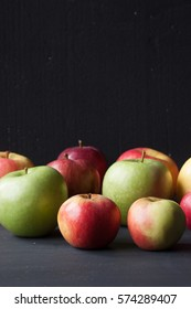 red and green apples on a black background
