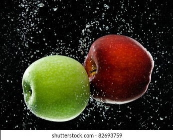 red and green apples in water
