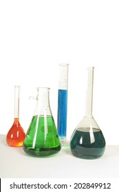 Red, green and blue liquids in medical flasks of different shapes and sizes