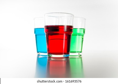 red green and blue water color in glass