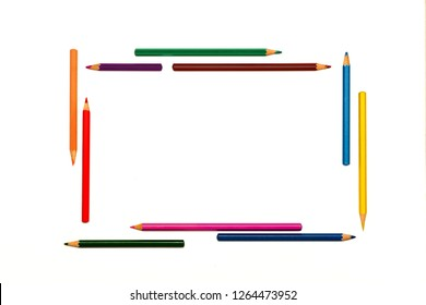 Red, green, blue, yellow, orange, brown, purple pencils formed frame and isolated on white. Borders and frames concept. Back to school. Empty background with lot of space for text, advertising design.