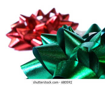 red and green bow isolated on white. shallow depth of field. focus on green bow.