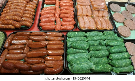 Red and green chorizo sausages on a market table