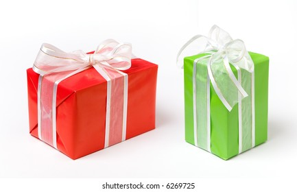 Red and green Christmas gifts on white isolated background