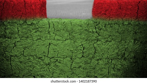 A red and green clay made structure isolated unique photo