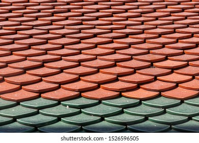 red and green colored shingles in pattern on roof