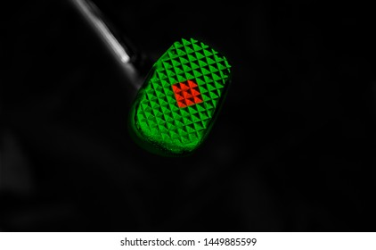 Red and green colour painted on a bike's brake paddle