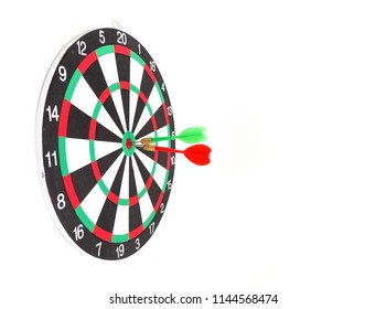 Red and green dart arrow hitting in the target classic dartboard, Business and competition to goal concept.