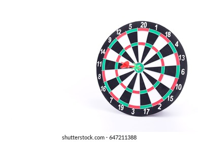 Red and green dart arrows hitting in the target center of dartboard